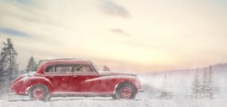Toward adventure! Girl relaxing and enjoying road trip. Happy young woman drives vintage car on snowy winter nature background. Christmas holidays time.