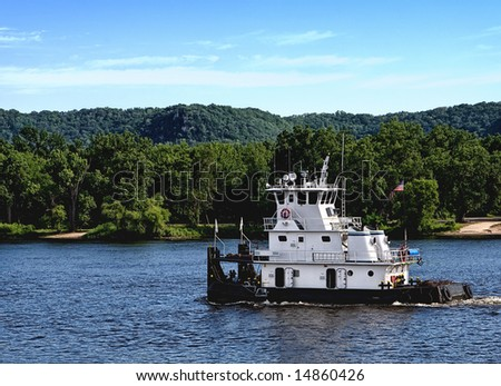 Towboat on the Mississippi River. - stock photo