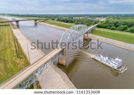 Towboat passing under bridges on the Chain of Rocks Canal of MIssissippi River above St Louis - aerial view