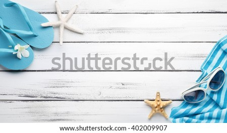 Towel and beach slippers on wood,summer background.