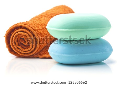 Towel and Stack of new Soap Bars on white background.