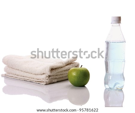 Towel, apple and a bottle with water - isolated on white background