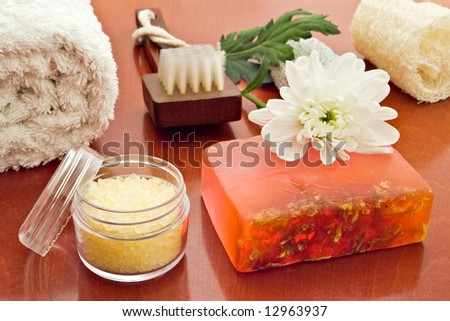 towel brush loofah sea-salt soap and flower arrangement