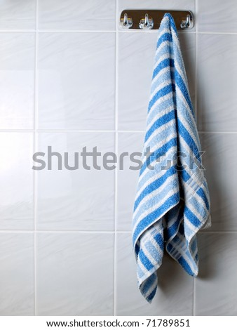 Towel  is hanging on a hanger in the bathroom...
