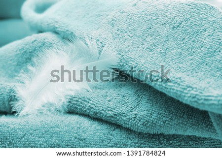 Towel softness of material as feather #1391784824