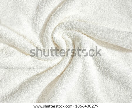 Towel texture close up. Terry cloth bath or beach towel. Soft fluffy textile. Top view. White towel macro material. Stockfoto ©