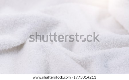 Towel texture closeup. Soft white cotton towel backdrop, fabric background. Terry cloth bath or beach towels. Soft fluffy Textile. Macro, texture  Stockfoto ©