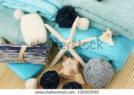 Towels and decoration on bamboo mat.