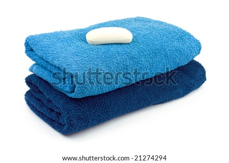 Towels and piece of soap isolated on white background