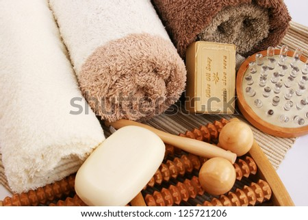 Towels and spa set on mat background.