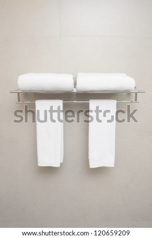 towels for couple prepared on hanger.