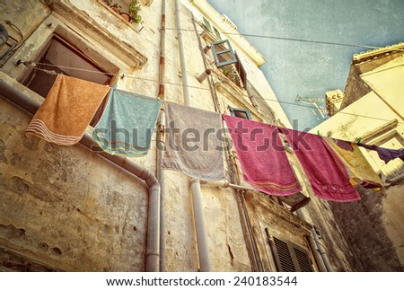 Towels hanging on a clothes line in Corfu Old Town