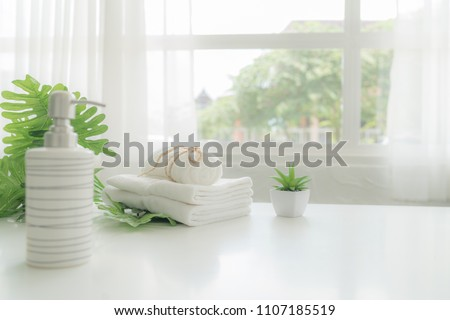 Towels on white wood top table with copy space on blurred background. For product display montage.