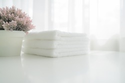 Towels on white wood top table with copy space on blurred bathroom background. For product display montag