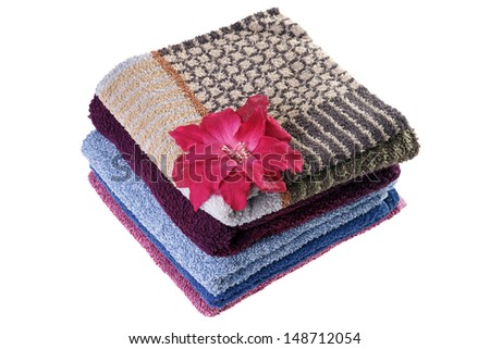 towels with a flower isolated over a white background / wellness