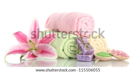 towels with beautiful pink lily, aroma oil and sea salt isolated on white - stock photo