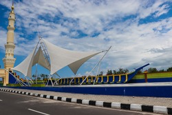 tower and ship sails as the entrance gate for the pedestrian bridge to Dompak Island