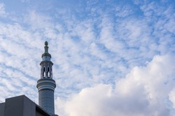 tower architecture with dramatic cloud view