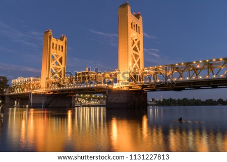 Tower Bridge and lights reflected on the Sacramento River. Sacramento and Yolo Counties, California, USA. #1131227813