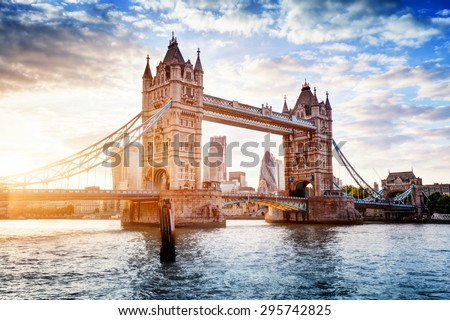 Tower Bridge in London, the UK. Sunset with beautiful clouds. Drawbridge opening. One of English symbols #295742825