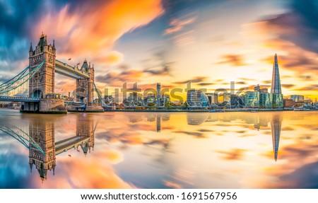 Tower Bridge sunset panorama reflected in river Thames. London