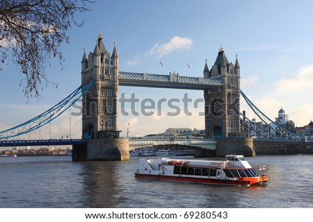 Tower Bridge with boat, London, UK