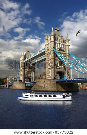 Tower Bridge with city cruise in London, UK