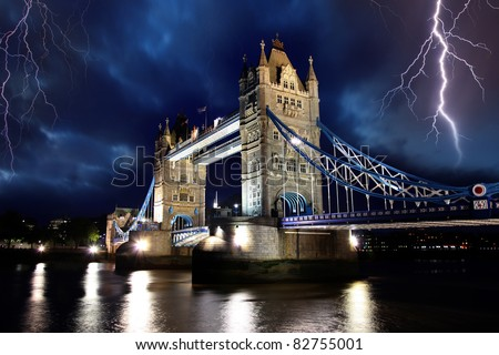 Tower Bridge with lightnings at stormy night in London, UK