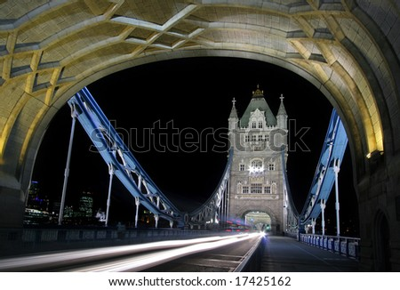 Tower Bridge with traffic at night, London