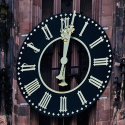 Tower clock of the cathedral of Frankfurt shows 2 minutes past twelve