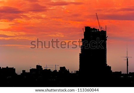 Tower cranes are used in construction work. Economic development in the city.