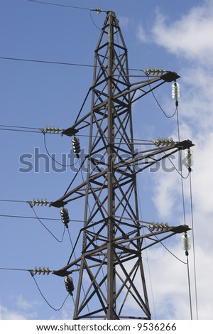 Tower for transmission electricy over sky and clouds background
