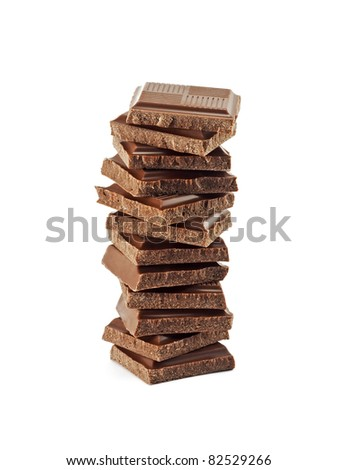 Tower from chocolate fragments on a white background