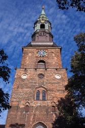 Tower from the historic St. Peter's Church, St.-Petri-Kirche, that persevered despite of the Copenhagen fires. Copenhagen, Denmark.
