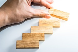 Tower Game with a Wooden. Wood block stacking as step stair. Business concept for growth success process. - Vintage tone.