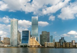 Tower Hamlets and financial  buildings in Canary Wharf area of London on the riverside of Thames