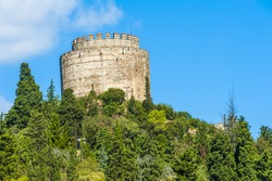 Tower of ancient medieval castle Rumeli Hisari built on a hill above a Bosphorus in Istanbul in Turkey. The fortress was constructed by Ottoman Turks in 15th century before the siege of Constantinople