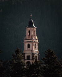 Tower of beautiful church in Cavalese, Italy