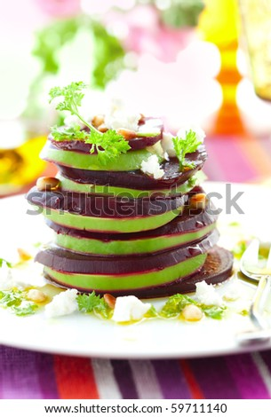Tower of beetroot ,goat cheese and avocado with pine nut