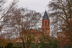 Tower of Church Saint Exupere Parish on 6 Lamarck Street near Museum of Toulouse, France.