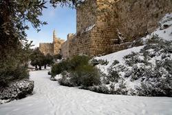 Tower of David in Jerusalem in winter in snow.