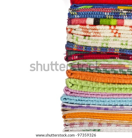 Tower of Kitchen towels on white background