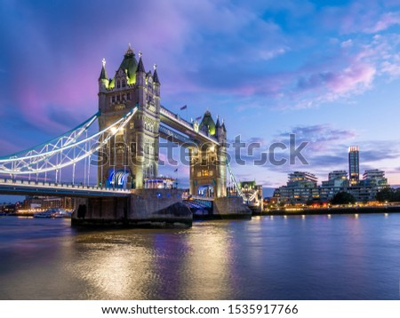 Tower of London Bridge build construct reflected in Thames river at dusk light in England, Great Britain