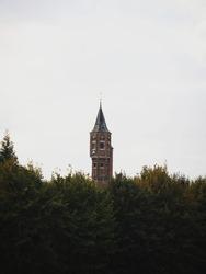 Tower of medieval archers guild Koninklijke Hoofdgilde Sint Sebastiaan schuttersgilde between trees in Bruges Belgium