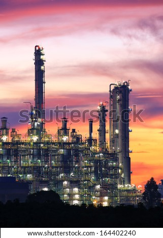 Tower of oil refinery at twilight sunrise