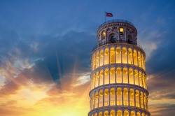 Tower of Pisa in Miracles Square, Illuminated at Night with sunset, Italy