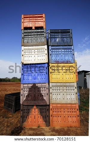 Tower of plastic boxes. - stock photo