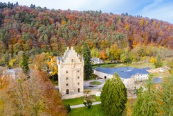 Tower of Schoenfels Castle, Mersch/Kopstal, Mamer or Valley of the Seven Castles in central Luxembourg. Fall in Luxembourg, hills covered with forest, spectacular red, gold and yellow autumn leaves.