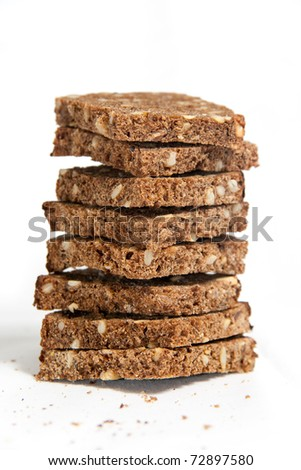tower of sliced rye bread, isolated on white background