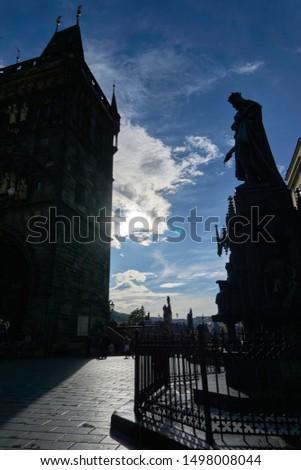 Tower of the bridge of Carlos in Praha and Carlos himself                     #1498008044
